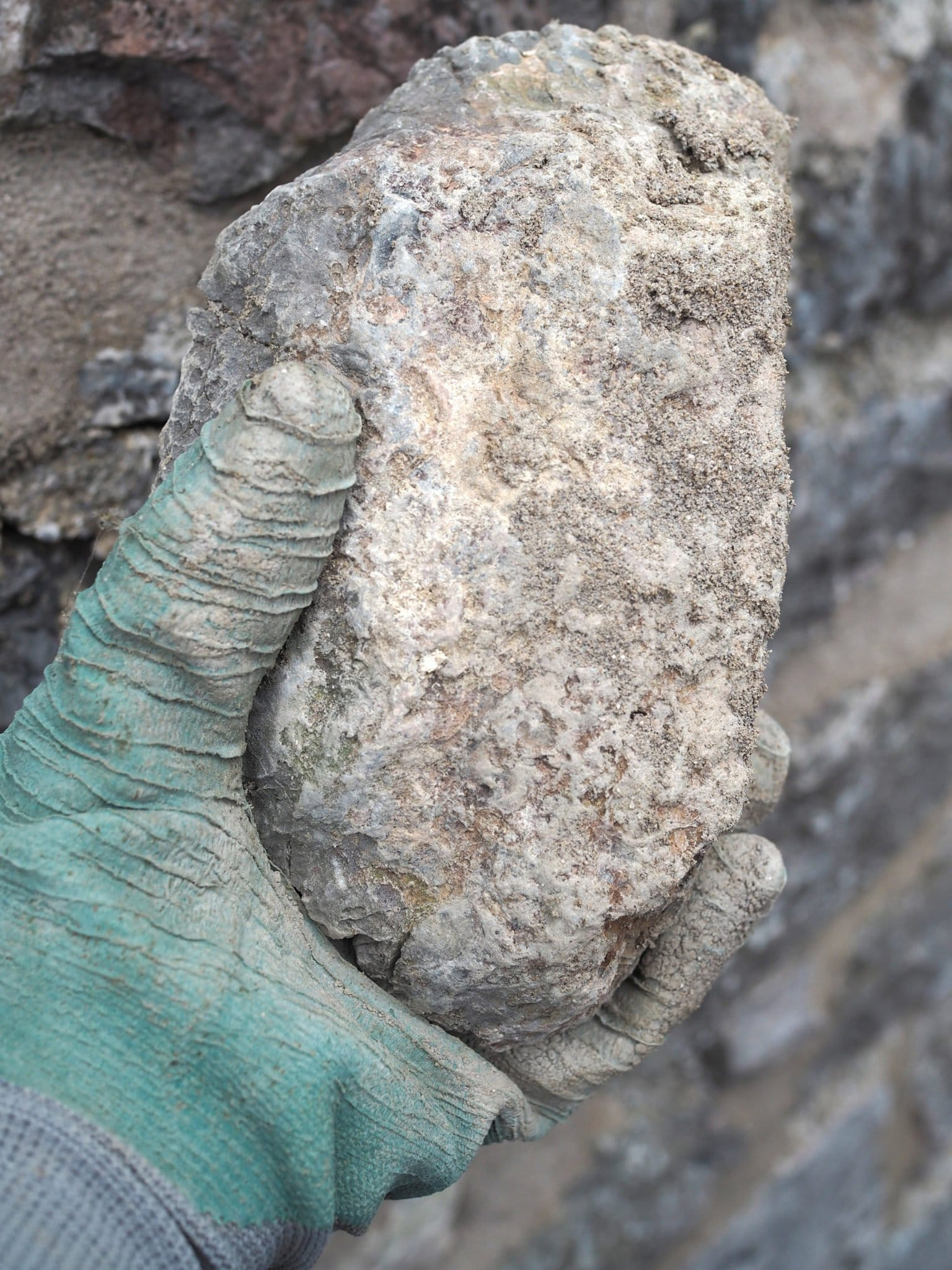 Put aside loose stones when repointing a wall
