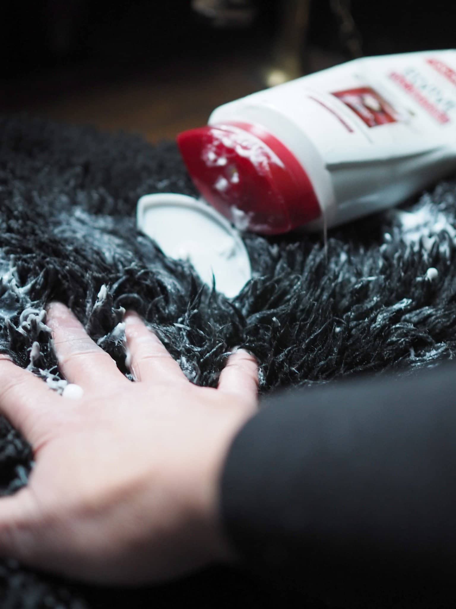 Massaging Hair Conditioner into a Sheepskin Rug