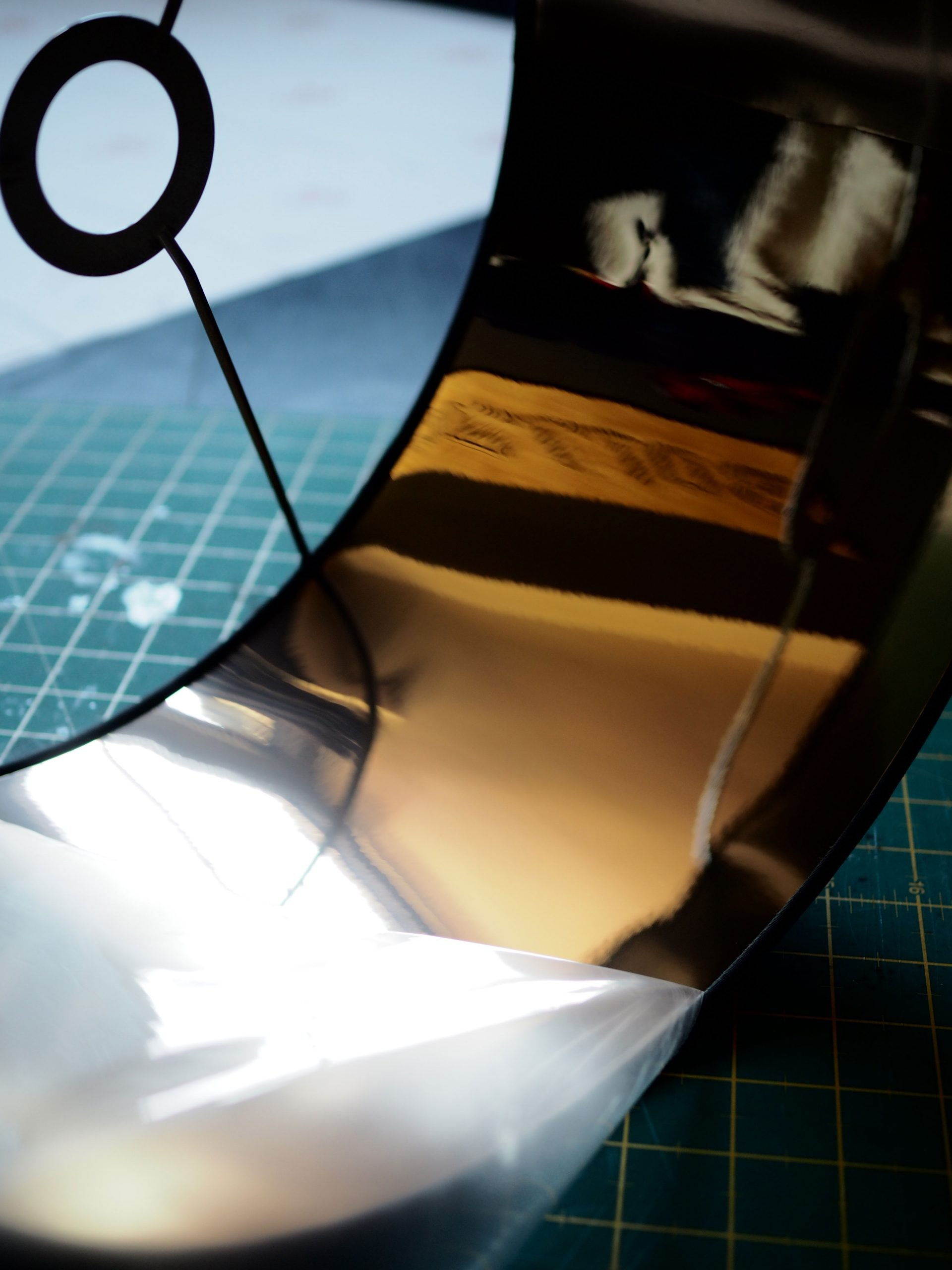 Removing the protective film from the gold lamp lining